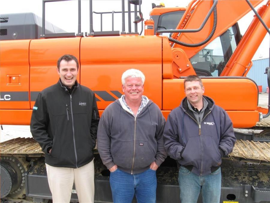 (L-R): Doosan Regional Manager Ron Hadaway discusses Doosan's line of construction equipment with Ken Worley of Miami Valley Contractors and Mark Stearns of Bobcat Enterprises.