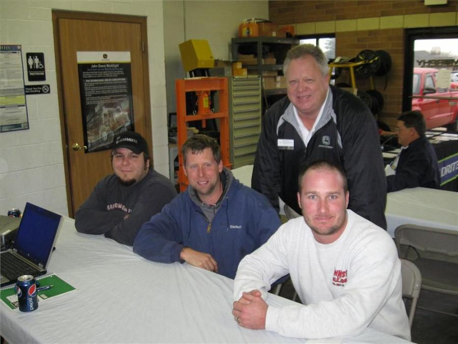 Murphy Tractor & Equipment's Mark Hash (standing) welcomes (L-R) Dan DeBenedictis and Matt Pfeiffer of Green Acres Lawn Service and Jeff Cerny of JLC Landscape to the Painesville, Ohio, open house.