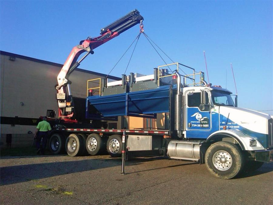 With the help of Palfinger dealer Tiffin Loader Crane, Specialty Oilfield Solutions was able to design and build trucks that not only hold the articulated crane, but also the 8,600-lb. (3,900 kg) centrifuge units.