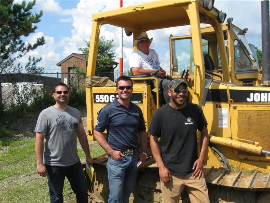 (L-R): Bryon Ritchie, Jason Carrick, Matt Sucker and Ed Carrick (in cab) of Ritchie Construction Limited came to the auction in hopes of picking up a dozer and a vibrator.