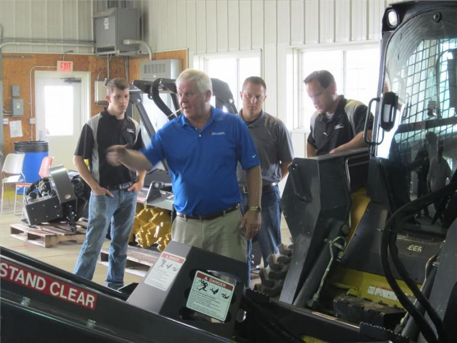 Dave Aldrich of Paladin goes over the features of the Bradco Hi-Flo ground shark extreme duty brush cutter.
