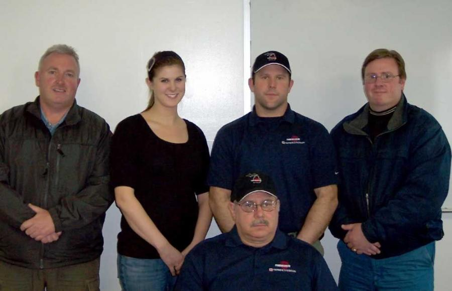 Members of the Powerscreen of Michigan LLC team are President Donald Northey (seated), (L-R) Dave McEvoy, west Michigan sales; Theresa Spain, parts manager; Tim Northey, Detroit, downriver sales and Tim Bobich, east Michigan sales.