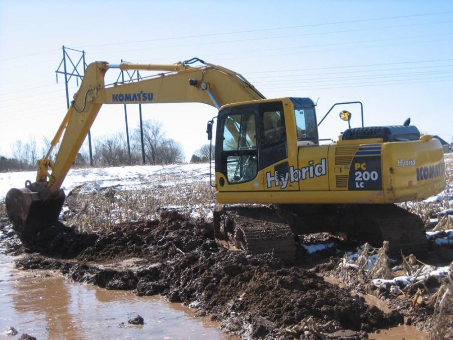 Russ Peters, Red's Excavating vice president, operates the Komatsu PC 200LC hybrid excavator.