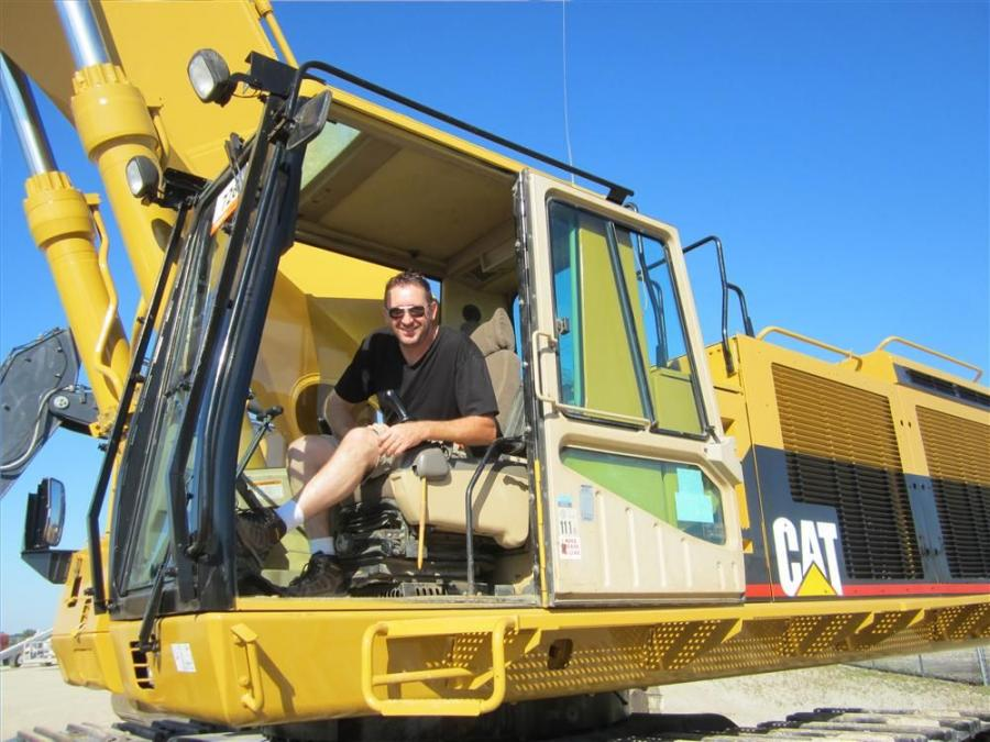 In the cab of this Cat 385BL excavator is Joe Hession of Hession Sewer Co.