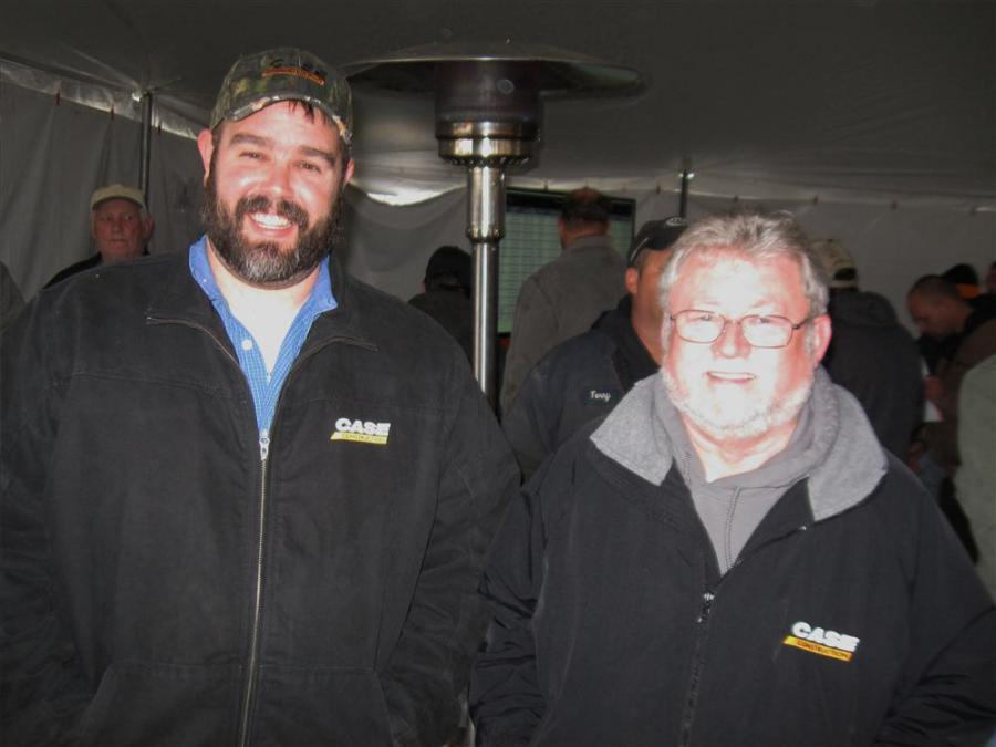 Tony Portman (L) and Rick Nation stops by to take in the auction activities.