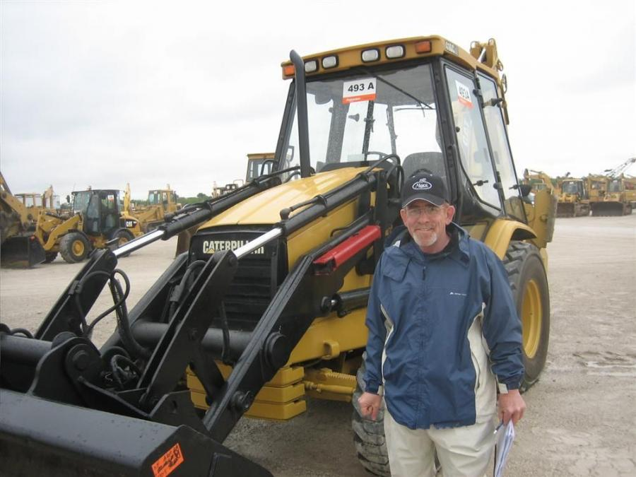 Randy Williamson of Dino Piergallini & Sons, Cadiz, Ohio, came to see if he could take this Cat 416 loader backhoe back to Ohio.
