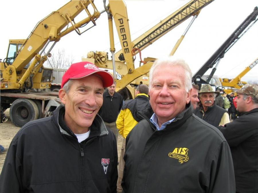 Steve Jackson (L) of Jackson-Merkey Contractors is joined by Larry Behrenwald of AIS Construction Equipment to watch the auction activities.