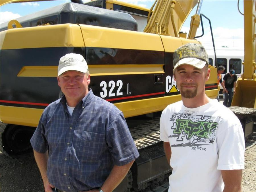 David (L) and Kurtis Greaves of Greaves Trucking hope to take home a compactor from the auction.