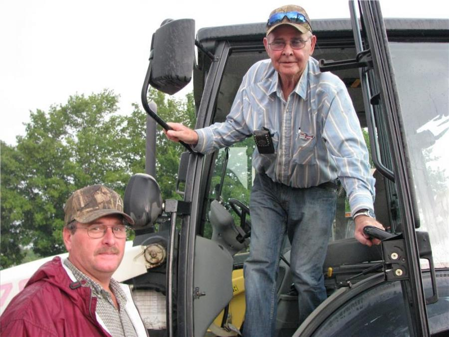 Taking a good look at a Terex TX 760B backhoe loader are Brady Matney (L) and Earl Matney of Matney Dozer Service, Greensburg, Ky.