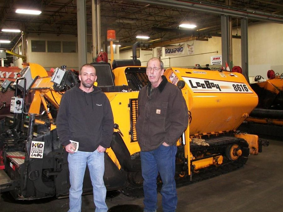 Jeremy Fortney (L), operations/ mechanic/sales, and Monte Sheldon, co-owner of Sheldon's Asphalt Paving of Viroqua Wis., check out a LeeBoy 8616.