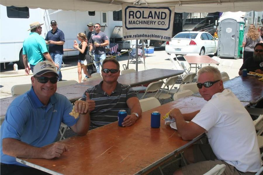 (L-R): Roland Machinery Sales Representative Brian Lauer takes a break with Jim and Roger Ahrens of Sonnenberger Asphalt during the racing event.