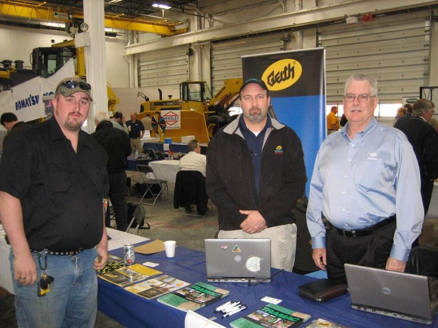 (L-R): Patrick Lairy, Schmit Construction, stops to see the latest from DII attachments and chat  with DII representatives Greg Clinton and Jeff Barnes.