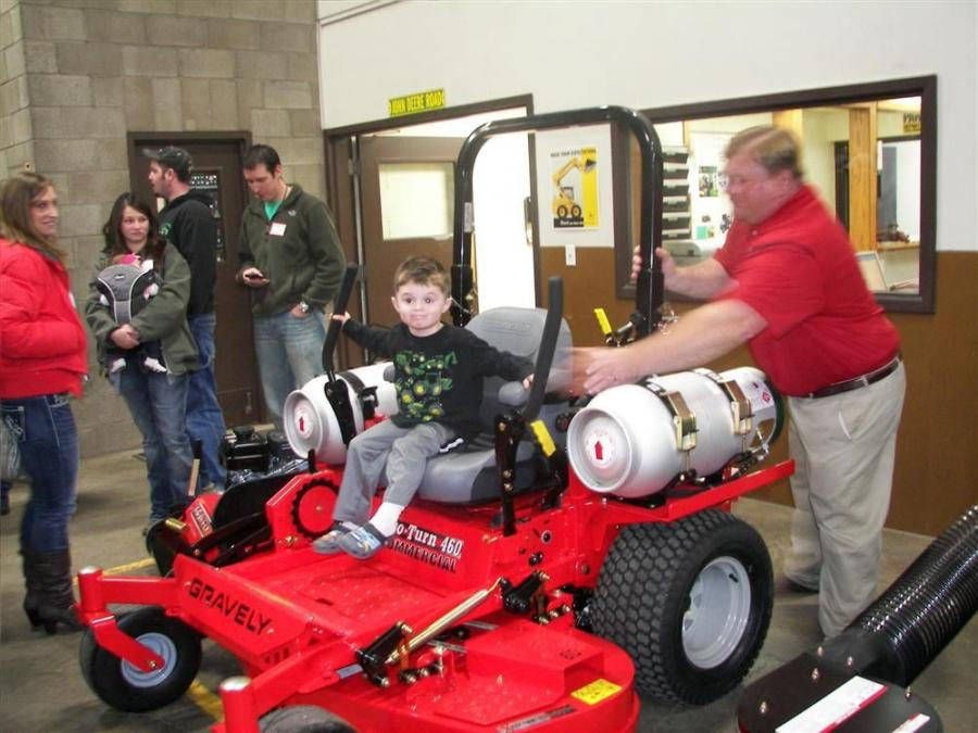 Dale Shequen, Midwest product specialist, Gravely, shows Beau Scharber (seated) how to work the new Gravely Pro-Turn 460 propane mower.