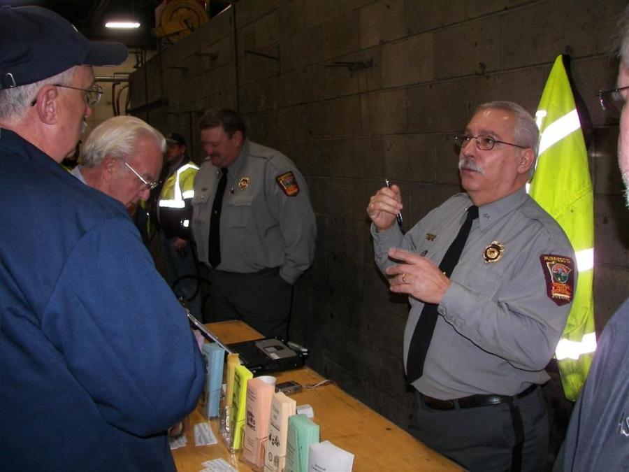 Officer Eric Sundby (L) and Officer Roger Istvanovich, commercial vehicle inspectors of the Minnesota Department of Public Safety were on hand throughout the event to answer questions about the new vehicle requirements that soon go into effect in Minnesot