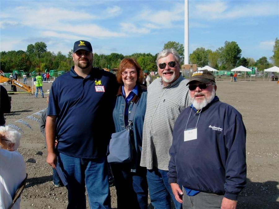 (L-R): Brad White, Nancy White and Dan White of Daniel White Construction, Milford, Mich., are greeted by Southeastern Equipment Company's Rod House.