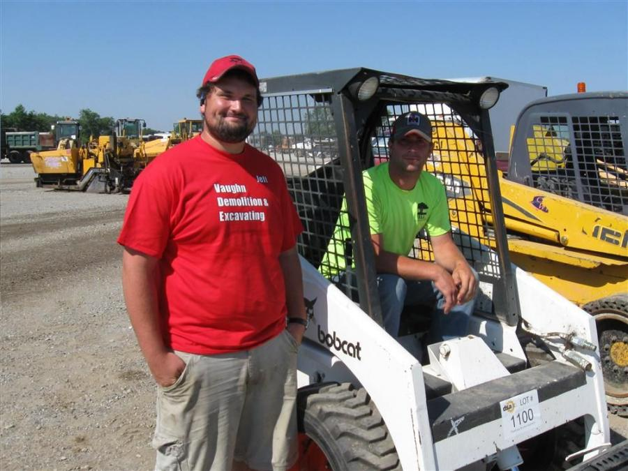 Jeff Vaughn (L) of Vaughn Demolition and Excavating joins Alex Hill of Hill Landscaping to check out this Bobcat skid steer.