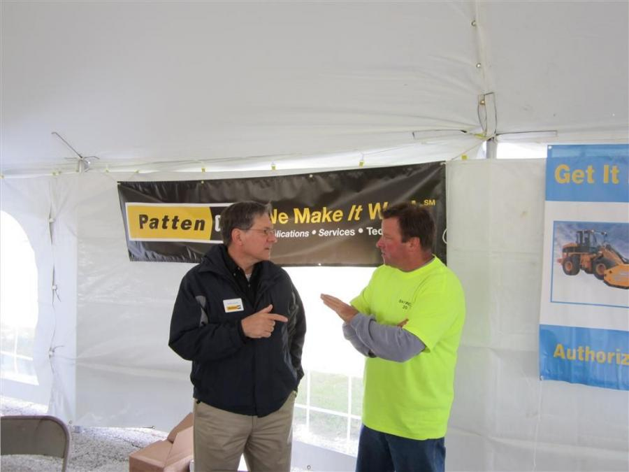 John Salek (L) of Patten Industries speaks with John Starek, director of operations of Arctic Snow & Ice Control, at the Snowfest 2011 in Frankfort, Ill.