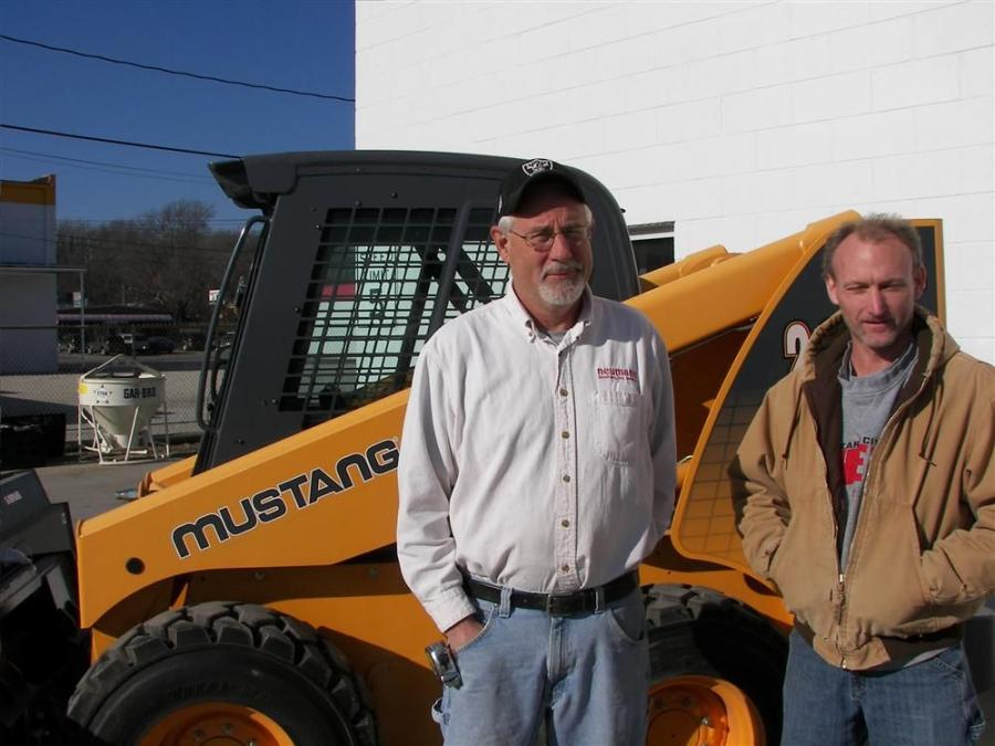 Regular customers and general contractors Joel Jensen (L) and Randy Erickson of Neumann Brothers, Des Moines, Iowa, check out the Mustang 2086 turbo while looking forward to the annual chili feed.