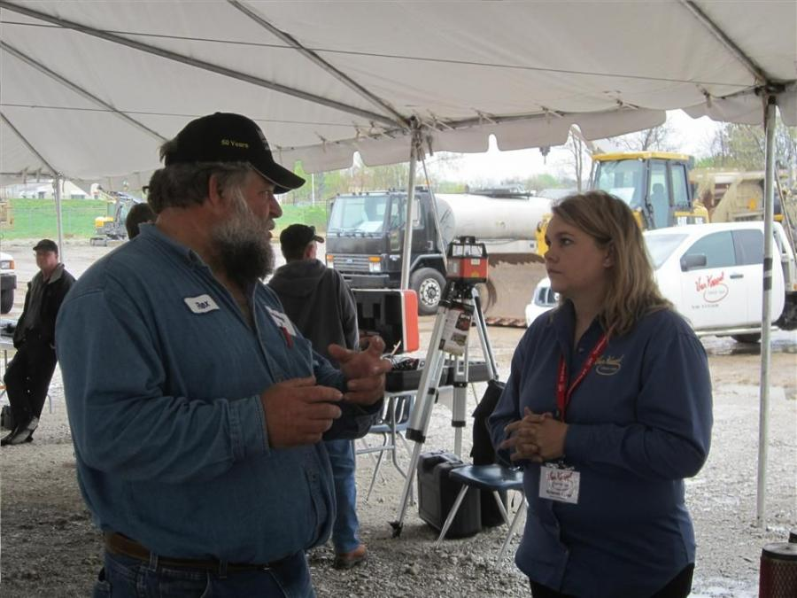 Rex Zabel, Leavenworth County, speaks with Krissy Lund, general manager of the used parts division, G.W. Van Keppel, about used parts.
