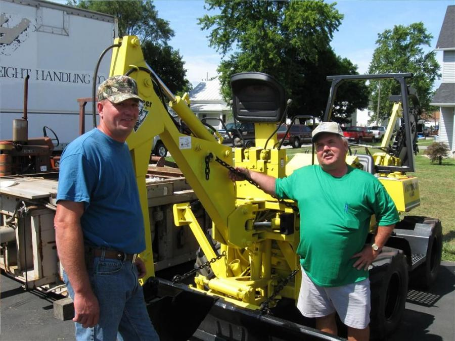 John Blausey (L) of Blausey Trucking and Excavating catches up with David Netcher of Netcher Farm Equipment, Elmore, Ohio.