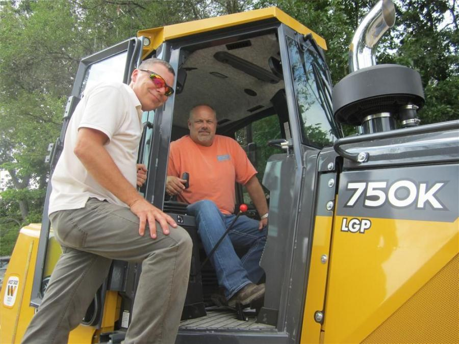 Russ Ciesiolka (L), Positioning Solutions Co., gives some instruction for the Topcon 3D-MC2 on the John Deere 750K  to Mark Osler of Indiana Earth.