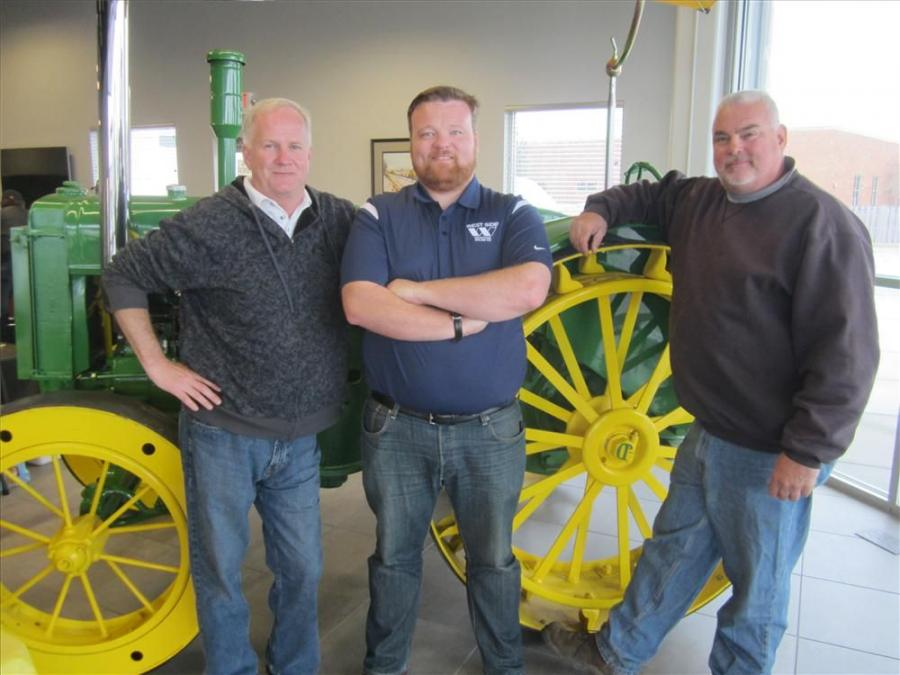 (L-R): Jeff Crafton and Pat Carroll, both of West Side Tractor, greet Dave Konopko of ECC Demolition.