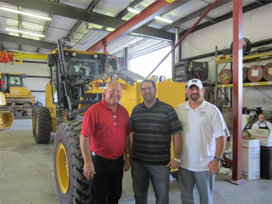 Bob Wright (L) of West Side Tractor Sales Co. shows the newly renovated facility to Eldon Byler and Eric Strebig both of Strebig Construction.