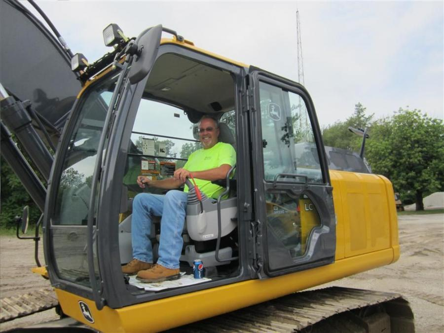Feeling right at home in the cab of this John Deere 210G excavator is Dave Geyer of Geyer Construction.