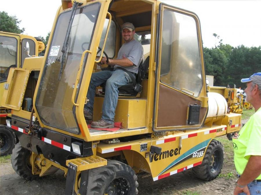 Aaron Smith of Smith Paving gets behind the controls of this Vermeer CC155 concrete cutter.