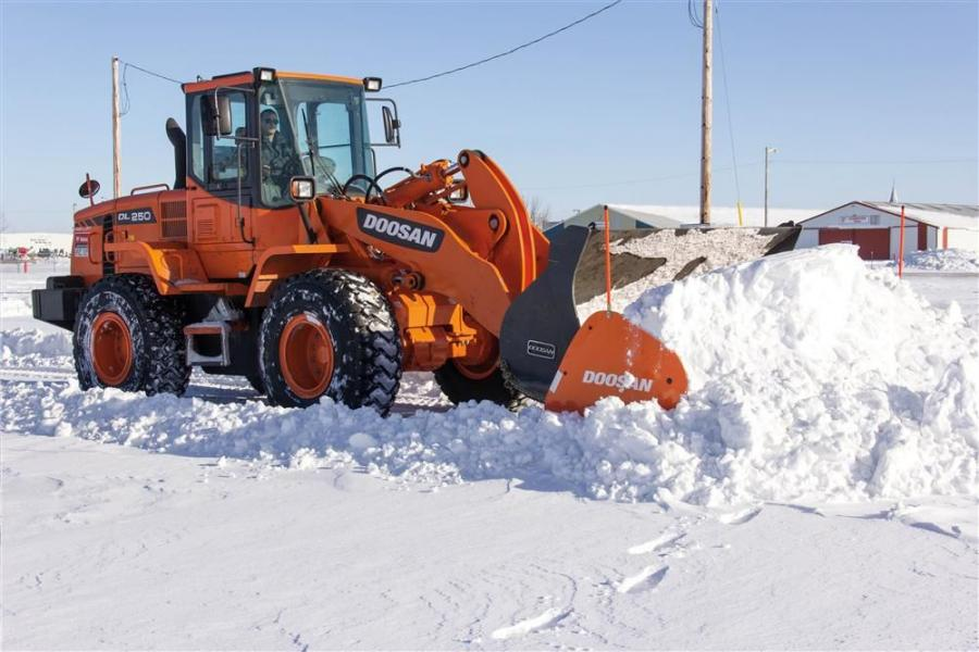 A 12-ft. (3.6 m) wide attachment weighs 2,200 lbs. (998 kg) and the 14-ft. (4.2 m) wide version weighs 2,400 lbs. (1,088 kg), offering snow removal contractors and municipalities an alternative to buckets and traditional plowing when cleaning parking lots