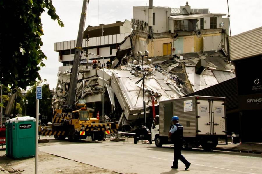 Photo courtesy of Gabriel Goh.  The collapsed Pyne Gould Building in Christchurch, New Zealand.