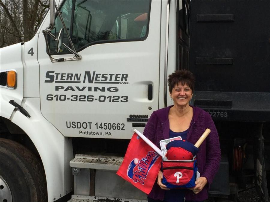 Wendy Nester-Schiavo, of Stern Nester Paving in Pottstown, Pa., won Atlas Copco's baseball package at World of Asphalt 2015 by downloading the Atlas Copco Construction App.