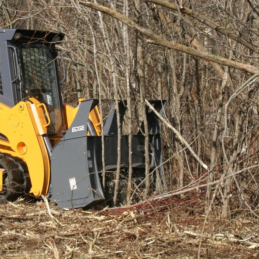 The new standard-flow EDGE mulcher attachment is equipped with a safety pusher bar to force brush or small trees down and allow the mulcher teeth to contact the lower portion of the brush to mulch it.  The rest of the plant is mulched as the machine moves