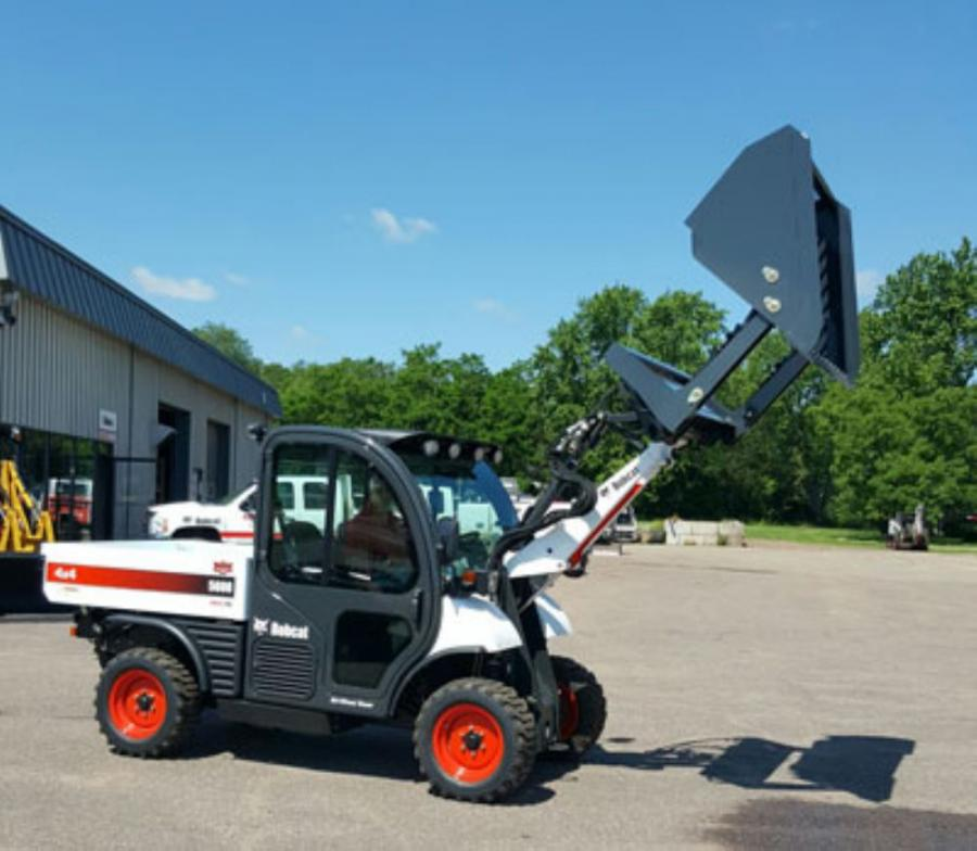 Virnig's 60 in. (152 cm) high dump bucket attachment utilizes two-cylinders to tip the bucket forward and allows the operator to increase the dump height without the need for a bigger loader.