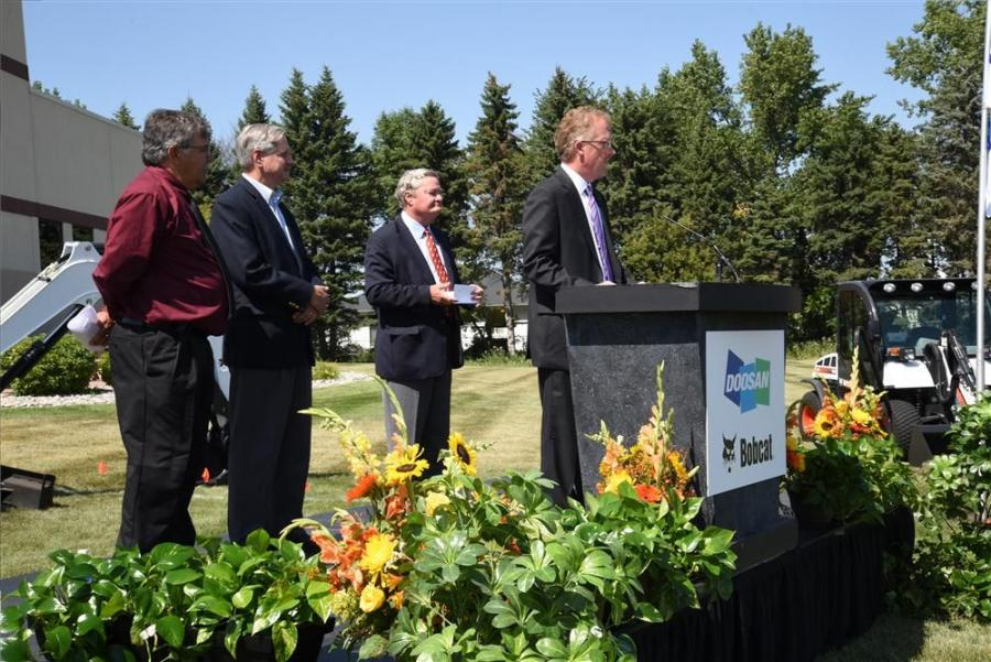 Several individuals delivered remarks during the groundbreaking ceremony. (L-R) are Rich Mattern, mayor of West Fargo, N.D.; U.S. Sen. John Hoeven; North Dakota Gov. Jack Dalrymple; and Rich Goldsbury, president of Bobcat and Doosan, North America.