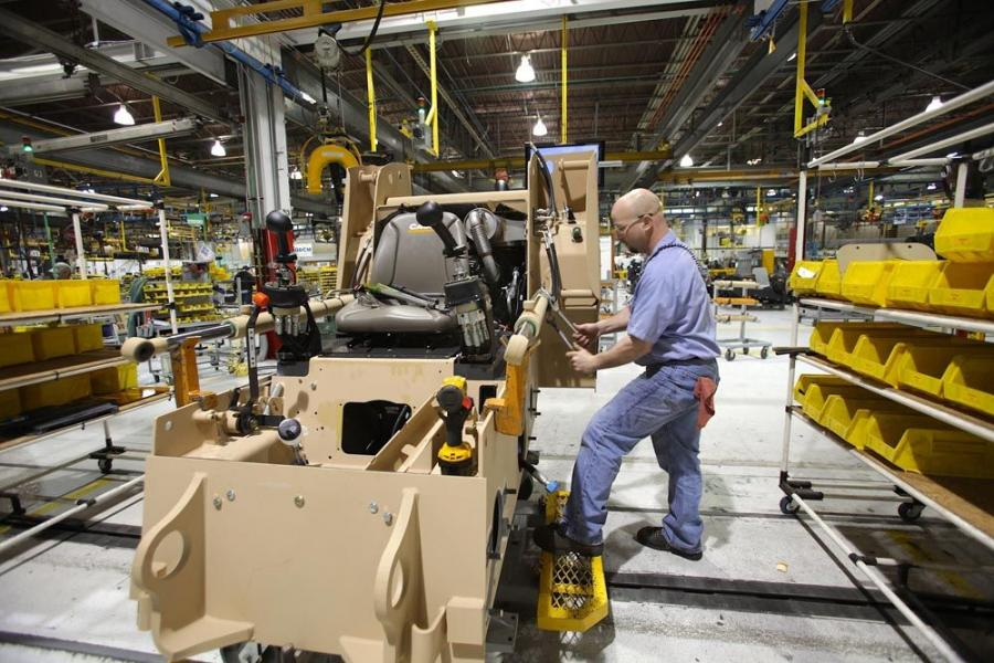Assembly of each machine requires approximately 40 hours of labor. Here, a CNH worker installs hydraulic system components on a M400T compact track loader.
