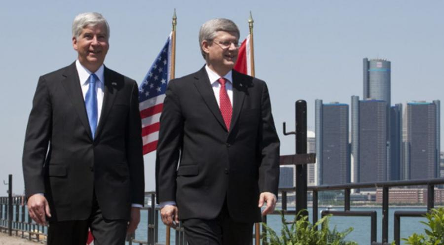 Michigan Governor Rick Synder (L) and Canadian Prime Minister Stephen Harper announce signing of an agreement for the construction of the new Detroit River International Crossing.  Photo courtesy of The Office of the Prime Minister of Canada.