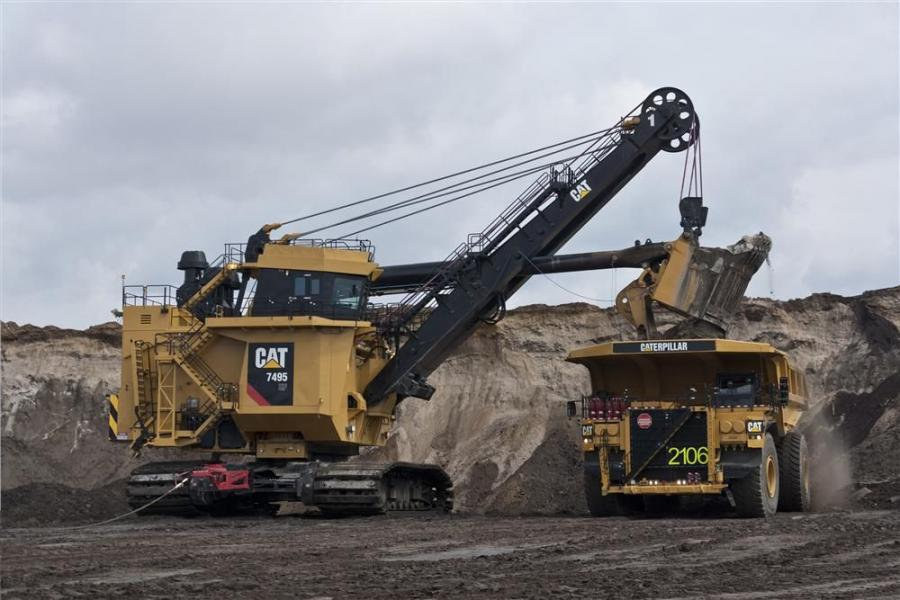 Cat 7495 HF electric rope shovel with new Cat shovel cab loads 797F truck.