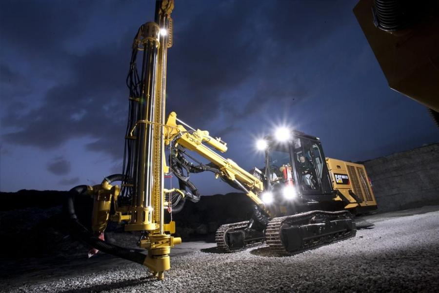 The Cat MD5150 track drill working at night.