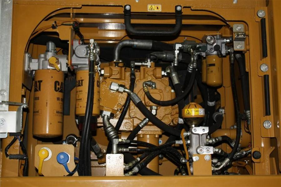 A look under the hood of the Cat 336E H hydraulic hybrid excavator.