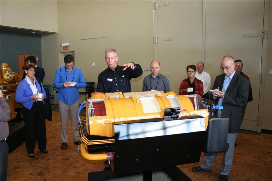Doug Mihelick, commercial manager of Caterpillar, uses a cutaway to show how Tier IV technology works, and how easy the next step is for the company, since all the technology that is used in Tier IV was introduced in Tier IV interim products.