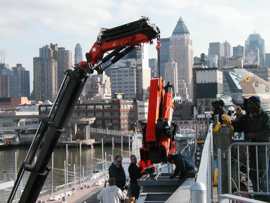 The Palfinger PK 150002G with PJ 170E jib setting the Palfinger 16502B in its position on the USS Intrepid.