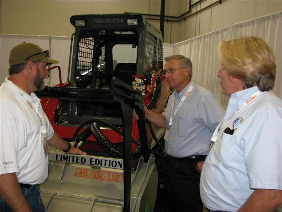 (L-R): Allen Tennis, midwest regional representative of FAE USA, talks about the new FAE UML/SSL-150 VT mulcher with Paul Gick of B&W Equipment Co., Fort Wayne, Ind., and Rick Roberts of Lashley Tractor Sales, Lithonia, Ga.