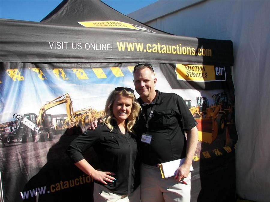 Brooke Sanders, marketing coordinator, and David Baugous, strategic accounts manager, both of Cat Auction Services' Eagan, Minn., headquarters enjoy the warm weather at the Florida Auctions.