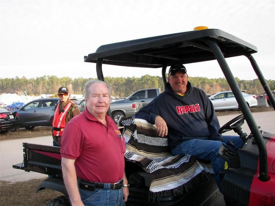 (L-R): Arriving at the Alex Lyon & Son auction is Dick Courts (L) of Courts Machinery, Windom, Minn., and Kenny Bell of Clark Auctions, Clark, S.D. They're enjoying the great weather and looking forward to checking out all the equipment.