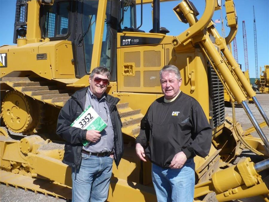 Richard Mallet (L), international sales representative of Hewitt Cat, and Dan MacLeod of Atlantic Cat enjoy reminiscing about old times.