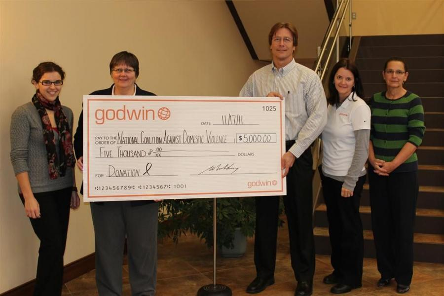Godwin recently made a donation to the National Coalition Against Domestic Violence (NCADV). (L-R) are Kristen Gurick, charitable contributions committee; Rita Smith, executive director of NCADV; Grant Salstrom, chief operations officer of Godwin; Stephan