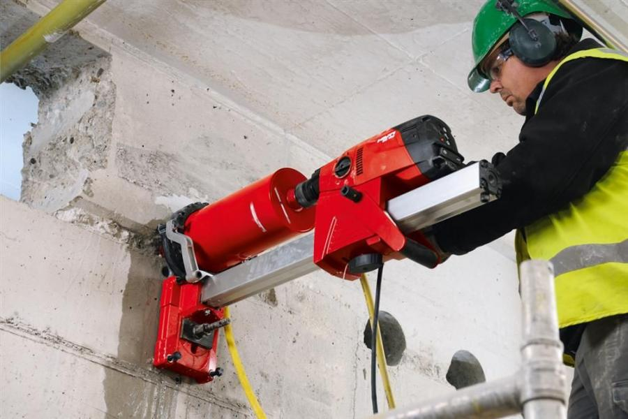 The Hilti DD 160 diamond coring system performs in rig-based wet coring work on concrete walls and floor decks, including drilling holes in diameters up to 8 in. (20 cm).