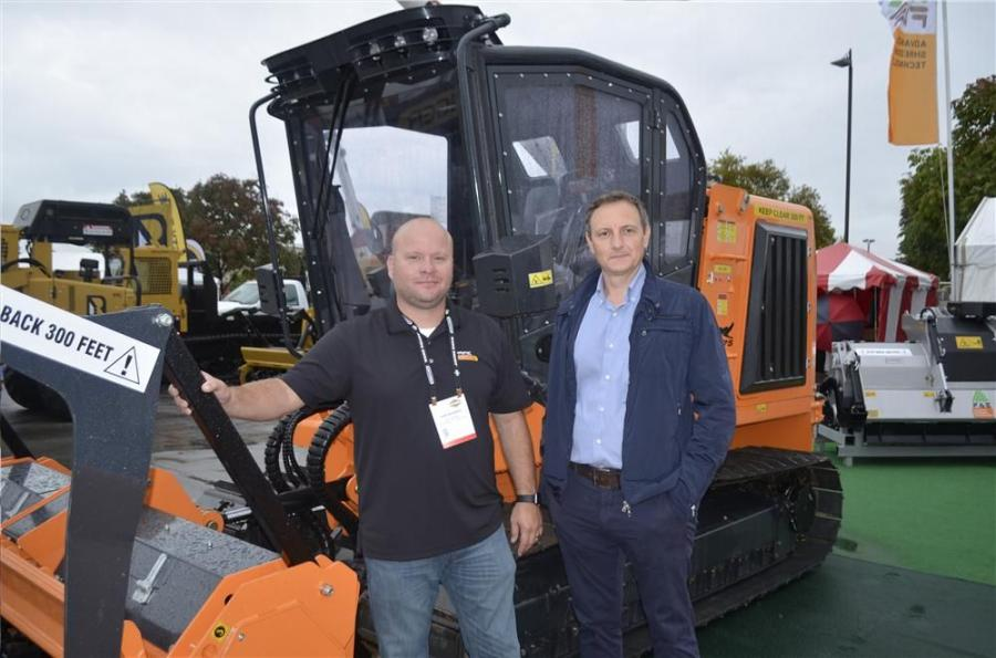 John DalBianco (L), national sales manager of Prime Tech, and Giorgio Carera, CEO of FAE, have a look at the new PT-175 wood mulcher.