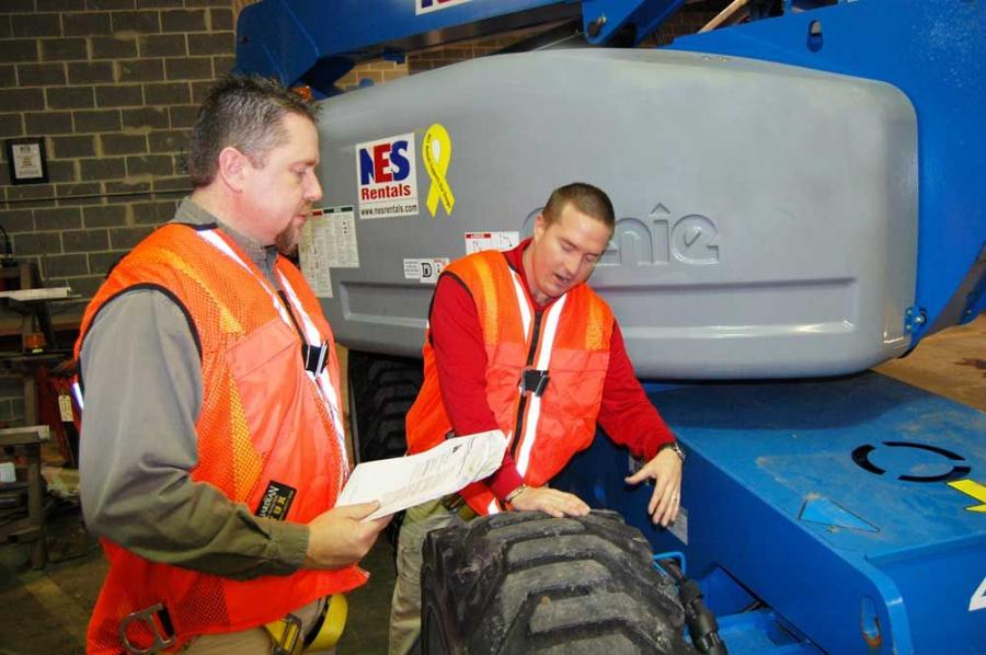 Chris Lewis (L), branch manager of NES, observed as Jeff Bowers prepared for the IPAF instructor train-the-trainer training.